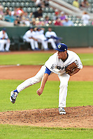 Trevor Oaks (52) of the Ogden Raptors delivers a pitch to the plate against the Great Falls Voyagers in Pioneer League action at Lindquist Field on July 18, 2014 in Ogden, Utah.  (Stephen Smith/Four Seam Images)