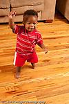 13 month old baby boy walking full length.