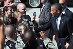 President Barack Obama greets members of the military after landing at Reno-Tahoe International airport, Tuesday, Aug. 21, 2012, in Reno, Nev..Photo by Cathleen Allison