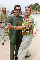 ARCHIVE: CANNES, FRANCE. c. May 1991: Sylvester Stallone & Arnold Schwarzenegger at the Cannes Film Festival.<br /> File photo © Paul Smith/Featureflash