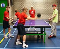 19-12-10, Tennis, Rotterdam, Reaal Tennis Masters 2010, Ballenkinderen spelen een partijtje tafeltennis in hun honk