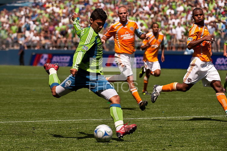 Fredy Montero (l) of the Seattle Sounders shoots against Ricardo Clark (r) of the Houston Dynamos in the match at the XBox Pitch at Quest Field on July 11, 2009. The Sounders defeated the Dynamo 2-1.