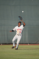 Reggie Pruitt (13) of the Vancouver Canadians catches a fly ball during a game against the Salem-Keizer Volcanoes at Volcanoes Stadium on July 24, 2017 in Keizer, Oregon. Salem-Keizer defeated Vancouver, 4-3. (Larry Goren/Four Seam Images)