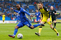 Junior Hoilett of Cardiff City crosses the ball into the box during the Sky Bet Championship match between Cardiff City and Burton Albion at the Cardiff City Stadium, Wales, UK. Friday 30 March 2018
