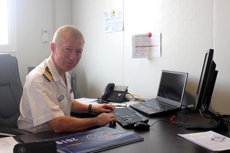 Irish Coast Guard Director Chris Reynolds at his desk in Somalia