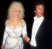 Dolly Parton Sylvester Stallone 1984<br /> Photo By John Barrett/PHOTOlink