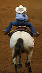 """3/15/07--Kylene Pickett is lifted out of her saddle as she sprints for the finish line on """"Go Avas Ace Glo"""" in the Youth Pole Bending competition for ages 13 and under in the Reliant Arena at the Houston Livestock Show and Rodeo Thursday.  Photo by Steve Campbell, Chronicle Staff. ."""