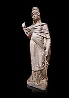 Roman statue of Julia Domina . Marble. Perge. 2nd century AD. Inv no 3268. Antalya Archaeology Museum; Turkey. Against a black background.<br /> <br /> Julia Domna (AD 160–217) was a Roman empress , the second wife of Septimius Severus (reigned 193–211).
