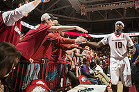 NWA Democrat-Gazette/ANTHONY REYES • @NWATONYR<br /> Bobby Portis, Arkansas sophomore, celebrates with the student section against Tennessee Tuesday, Jan. 27, 2015 in Bud Walton Arena in Fayetteville. The Razorbacks won 69-64.