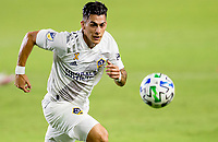 CARSON, CA - SEPTEMBER 27: Cristian Pavon #10  of the Los Angeles Galaxy moves to the ball during a game between Seattle Sounders FC and Los Angeles Galaxy at Dignity Heath Sports Park on September 27, 2020 in Carson, California.