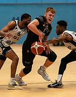 Cameron Hildreth of Surrey Scorchers splitting the Eagles defence during the BBL Championship match between Surrey Scorchers and Newcastle Eagles at Surrey Sports Park, Guildford, England on 20 March 2021. Photo by Liam McAvoy.