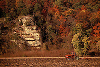 Tractor works the bluffs bordering the fertile bottomlands of the Missouri River in fall