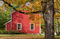 Charming red house with autumn foliage, Bennington, Vermont, USA.