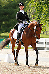 LEXINGTON, KY - APRIL 28: #15 Escot 6 and rider Colleen Rutledge in the warm up ring before their Dressage test in the Rolex Three Day Event, Dressage Day 1, at the Kentucky Horse Park in Lexington, KY.  April 28, 2016 in Lexington, Kentucky. (Photo by Candice Chavez/Eclipse Sportswire/Getty Images)