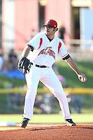 Nicholas Gonzalez #26 of the Salem-Keizer Volcanoes pitches against the Spokane Indians at Volcanoes Stadium on July 26, 2014 in Keizer, Oregon. Spokane defeated Salem Keizer, 4-1. (Larry Goren/Four Seam Images)