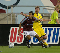 Pablo Mastroeni of the Colorado Rapids (red) and Eddie Gaven of the Crew battle for a ball along the sideline. The Columbus Crew defeated the Colorado Rapids 2-0, Sunday, July 27, 2008 at Dick's Sporting Goods Park in Denver, Colorado.