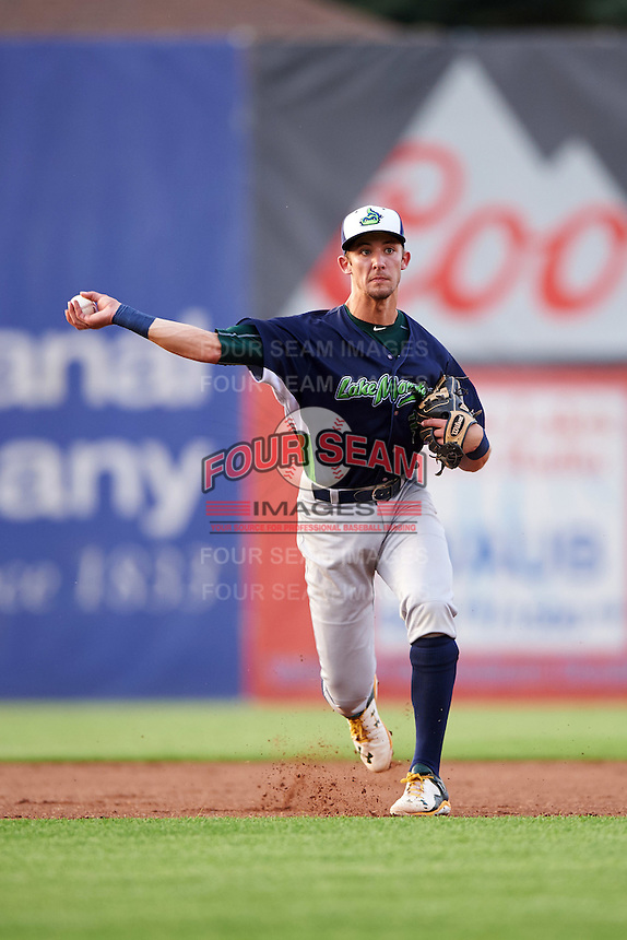 Vermont Lake Monsters shortstop Eli White (27) throws to first during a game against the Auburn Doubledays on July 12, 2016 at Falcon Park in Auburn, New York.  Auburn defeated Vermont 3-1.  (Mike Janes/Four Seam Images)