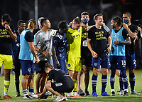 LAKE BUENA VISTA, FL - JULY 26: Sporting KC celebrate following the shootout during a game between Vancouver Whitecaps and Sporting Kansas City at ESPN Wide World of Sports on July 26, 2020 in Lake Buena Vista, Florida.
