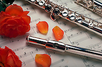 Flute with sheet music and flower petals