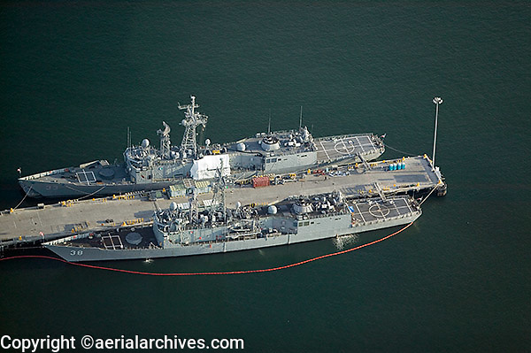aerial view above two United States Navy destroyers moored San Diego California