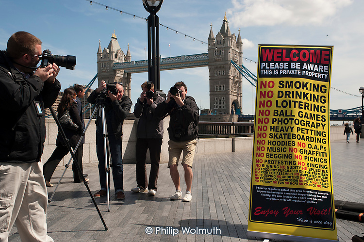 """Photographers' protest on the Thames Footpath outside City Hall to highlight restrictions on photography by security guards, and the privatisation of public space across London. Organised by the """"I'm a Photographer Not a Terrorist!"""" campaign and supported by the NUJ London Photographers Branch."""