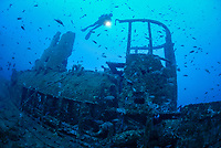 scuba diver explores the submarine wreck of Le Rubis, 130 feet ( 40 meters ) depth. sunk on purpose on January 31st, 1958 as an artificial reef, Saint Tropez, France, Mediterranean Sea