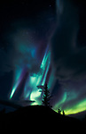 Clouds part to reveal a stunning display of the aurora borealis.