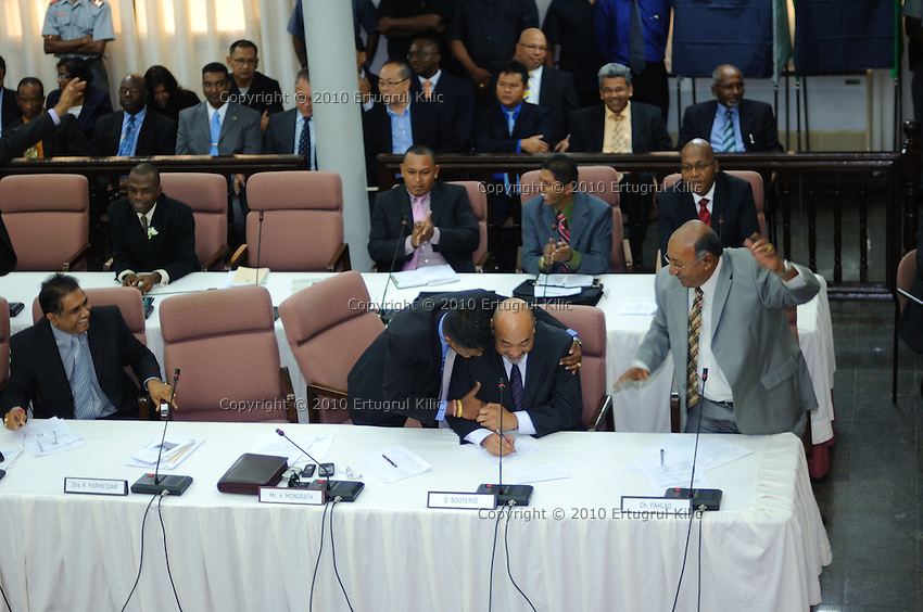Desi Bouterse (Desiré Delano Bouterse) gets first hug from Harish Monorath after his number of votes reached to 26 of 51 members ..Desi Bouterse (Desiré Delano Bouterse) chosen as new president of Suriname by De Nationale Assemblée (DNA) / The National Assemble of Suriname. He took 36 votes of 51 as leader of the Mega Combination. ....Robert_Ameerali the head of KKF (Kamer van Koophandel en Fabrieken) / Chamber of Commerce and Industry also selected as Vice President.....Desi Bouterse (Desiré Delano Bouterse) will sworn at 3 August 2010