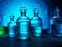 Glass stopper bottles containing hydrochloric acid.