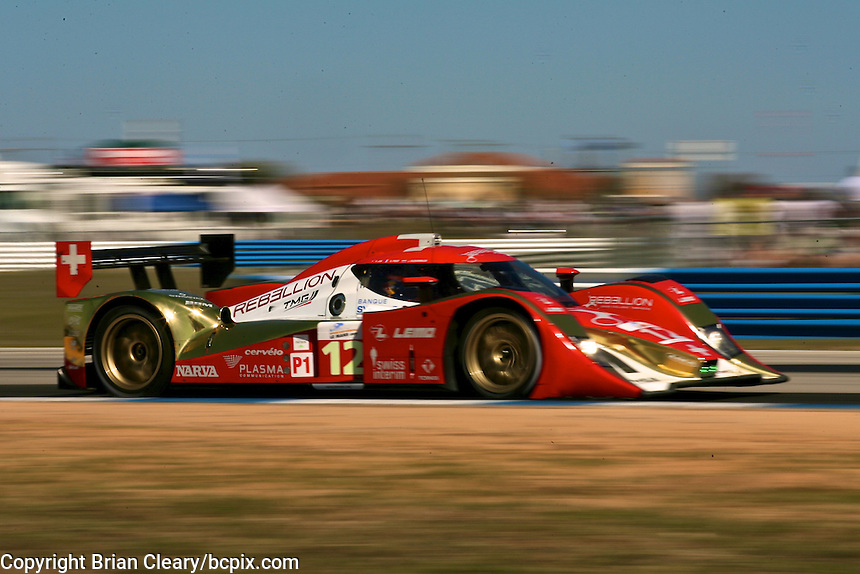 The #12 Toyota Lola of Nicholas Prost, Neel Jani, and Jaroen Bleekemolen  races through a turn during qualifying for the 12 Hours of Sebring, Sebring International Raceway, Sebring, FL, March 18, 2011.  (Photo by Brian Cleary/www.bcpix.com)