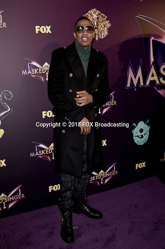 WEST HOLLYWOOD, CA - DECEMBER 13: Host Nick Cannon attends the premiere karaoke event for season one of THE MASKED SINGER on Thursday, Dec.13 at The Peppermint Club in West Hollywood, California. (Photo by Scott Kirkland/FOX/PictureGroup)