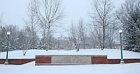 Snow falls over School of Law at the University of Virginia in Charlottesville, VA.