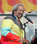 NEW ORLEANS, LA - MAY 05: Singer/musician Allen Toussaint performs during the 2012 New Orleans Jazz & Heritage Festival at the Fair Grounds Race Course on May 5, 2012 in New Orleans, Louisiana.