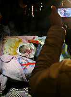 """The body of one-month-old Palestinian baby girl Amira Abu Akar, lies in her house during her funeral in Gaza City, on March 5, 2008. The baby and a senior Islamic Jihad militant were killed during an Israeli brief military incursion into Gaza today, overshadowing a new peace push by US Secretary of State Condoleezza Rice.""""photo by Fady Adwan"""""""
