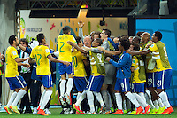 Brazil head coach Luiz Felipe Scolari celebrates with Neymar after he scored a goal making it 1-1