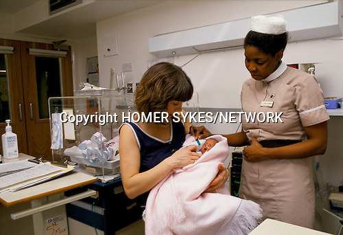 New mother with newborn baby, Portland Private hospital London 1990 1990s UK.