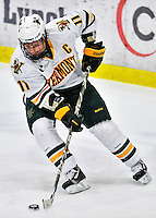 27 January 2012: University of Vermont Catamount forward H.T. Lenz, a Sophomore from Vienna, VA, attempts a wrap-around play against the Northeastern University Huskies at Gutterson Fieldhouse in Burlington, Vermont. The Catamounts fell to the Huskies 8-3 in the first game of their 2-game Hockey East weekend series. Mandatory Credit: Ed Wolfstein Photo