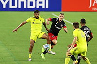 NASHVILLE, TN - SEPTEMBER 23: Anibal Godoy #20 of Nashville SC is defended by Russell Canouse #4 of DC United during a game between D.C. United and Nashville SC at Nissan Stadium on September 23, 2020 in Nashville, Tennessee.
