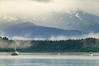 Boats and fog over the mountains of Bartlett Cove, Gustavus, Glacier Bay, Alaska