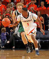 Nov. 15, 2010; Charlottesville, VA, USA; Virginia Cavaliers guard Jontel Evans (1) steals the ball from USC Upstate Spartans guard Carter Cook (33) during the game at the John Paul Jones Arena. Virginia won 74-54. Photo/