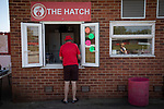 A home supporter purchasing a snack before Ilkeston Town host Walsall Wood in a Midland Football League premier division match at the New Manor Ground, Ilkeston. The home team were formed in 2017 taking the place of Ilkeston FC which had been wound up earlier that year. Watched by a crowd of 1587, their highest of the season, the match was top versus second, however, the visitors won 4-0 and replaced their hosts at the top of the division on goal difference with two matches to play