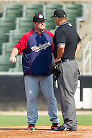 Hagerstown Suns manager Matt LeCroy #48 argues a call with home plate umpire Aaron Larsen during a South Atlantic League game against the Kannapolis Intimidators at Fieldcrest Cannon Stadium August 8, 2010, in Kannapolis, North Carolina.  Photo by Brian Westerholt / Four Seam Images
