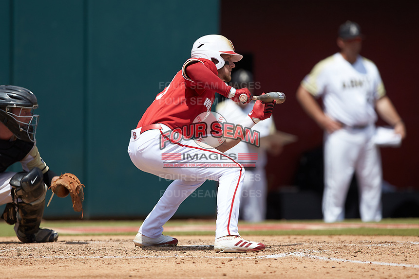 Brock Deatherage (13) of the North Carolina State Wolfpack squares to bunt against the Army Black Knights at Doak Field at Dail Park on June 3, 2018 in Raleigh, North Carolina. The Wolfpack defeated the Black Knights 11-1. (Brian Westerholt/Four Seam Images)
