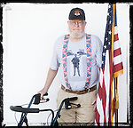 Veteran Roy Clark poses for a photo at a Veterans Day Program at the Oxford Conference Center in Oxford, Miss. on Thursday, November 11, 2010.