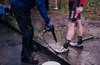 Belgian National CX Champion Laurens Sweeck (BEL/Pauwels Sauzen-Bingoal) getting his mudded shoes cleaned post-race<br /> <br /> Men's Race<br /> UCI Cyclocross World Cup Namur 2020 (BEL)<br /> <br /> ©kramon