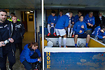 Greenock Morton 2 Stranraer 0, 21/02/2015. Cappielow Park, Greenock. The home team substitutes and backroom staff cram themselves into the home dugout before Greenock Morton take on Stranraer in a Scottish League One match at Cappielow Park, Greenock. The match was between the top two teams in Scotland's third tier, with Morton winning by two goals to nil. The attendance was 1,921, above average for Morton's games during the 2014-15 season so far. Photo by Colin McPherson.