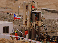 n this photo released by Chile's government, men work on a new drill to be used in the rescue operation of 33 trapped miners at the San Jose mine in Copiapo, Chile