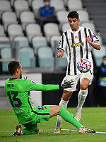 Football Soccer: UEFA Champions League -Group Stage-  Group G - Juventus vs FC Barcellona, Allianz Stadium. Turin, Italy, October 28, 2020.<br /> Juventus Alvaro Morata (r) in action with Barcellona's goalkeeper Neto (l) during the Uefa Champions League football soccer match between Juventus and Barcellona at Allianz Stadium in Turin, October 28, 2020.<br /> UPDATE IMAGES PRESS/Isabella Bonotto