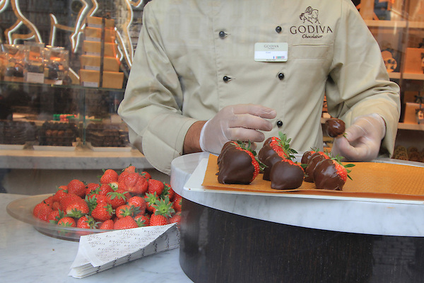 Belgium, Brussels. Still-Lifes<br /> Creativity can be discovered in many window displays. Dipping strawberries into chocolate in the Grand Place.