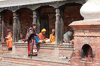 Pashupatinath, Nepal.  Sadhus, Hindu Ascetics or Holy Men, Rest inside a Pati, an Open-Air Resting Place.